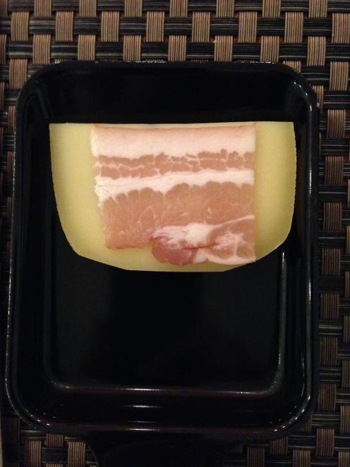 Raclette Käse mit Speck